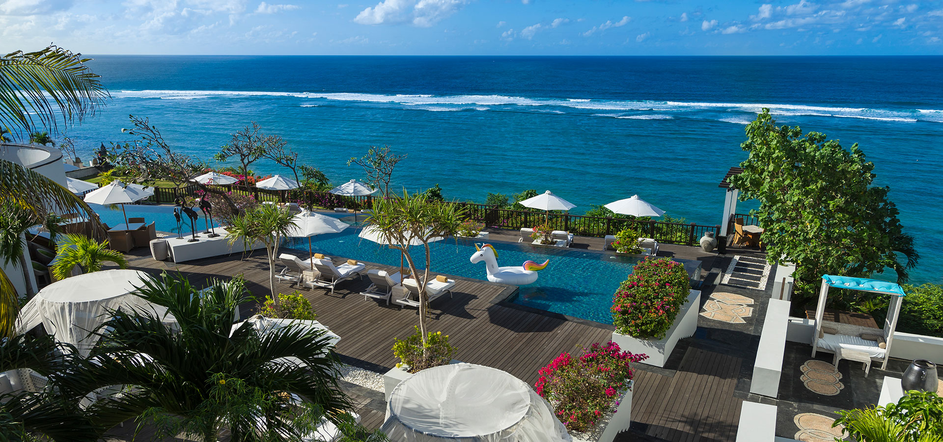 Pool Beach front view at Samabe Bali Suites & Villas